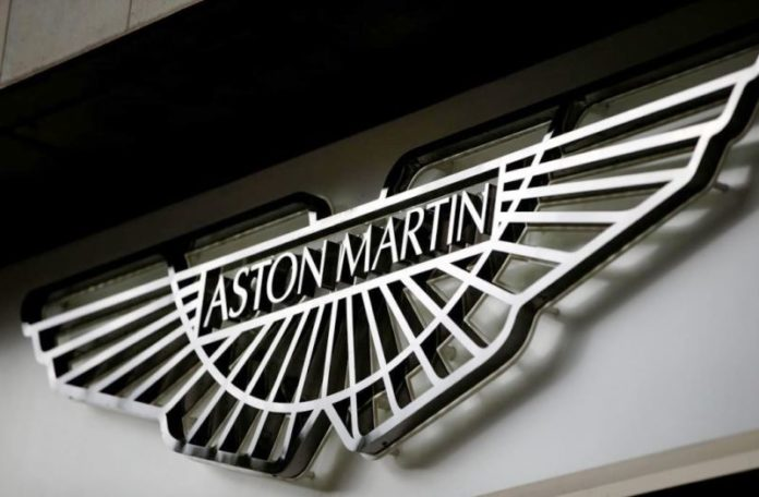Carmaker Aston Martin's adjusted pre-tax profit falls