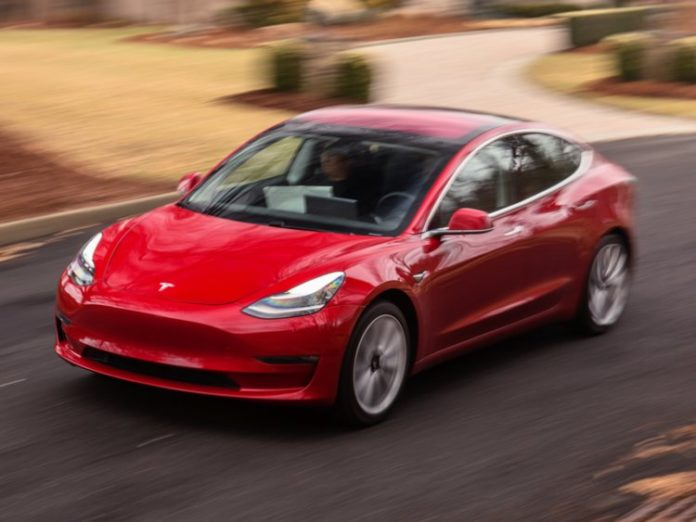 Tesla debuts $35,000 Model 3, sees loss in first quarter...